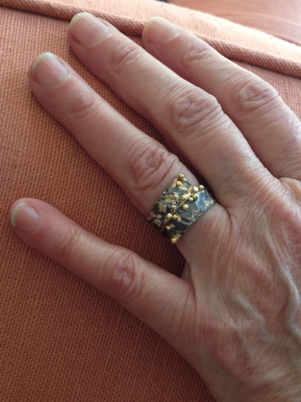 This is the lovely hand of Cynthia who was a pleasure to create this ring for.