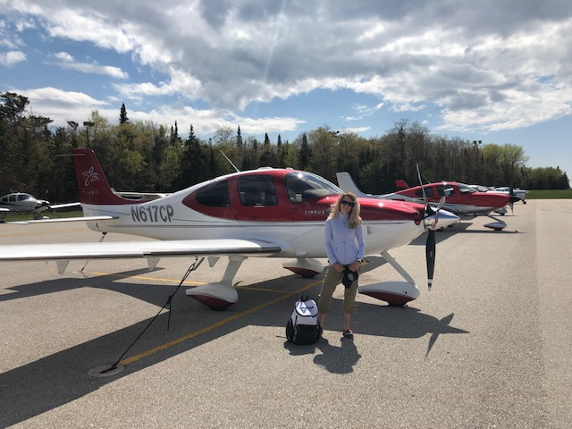 Miguel Daccarett Wife with Plane.jpeg