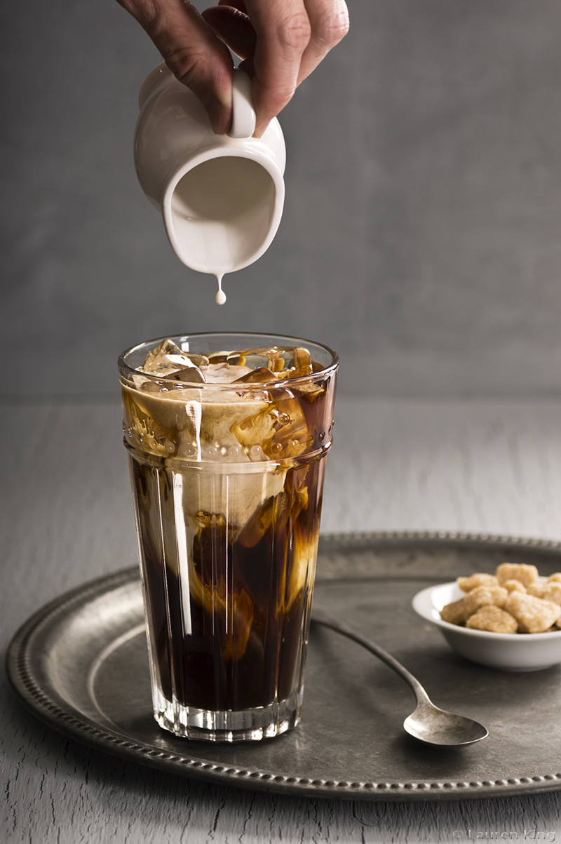 Pouring Cream Into Iced Coffee