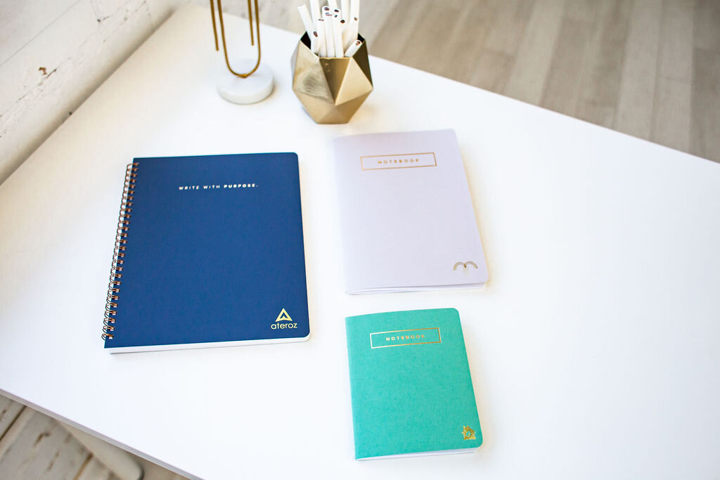 Examples of Marie Mae's corporate branded notebooks. Keep it subtle.