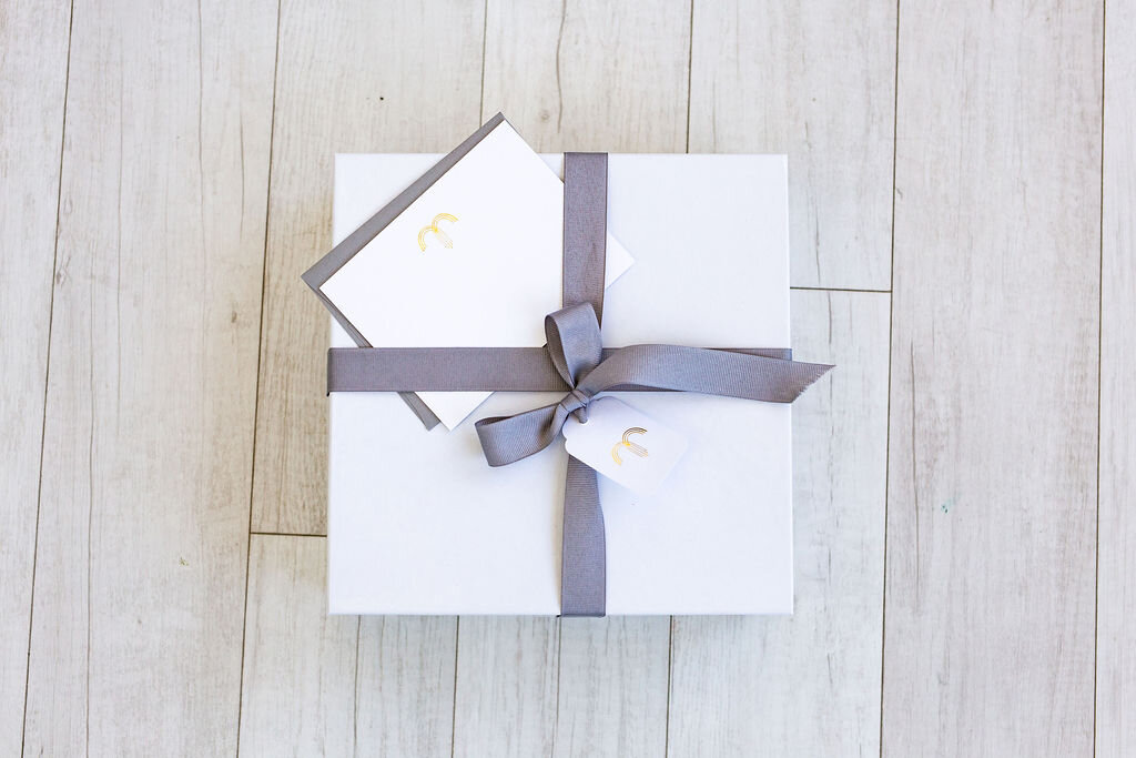 Examples of Marie Mae's branded gift packaging