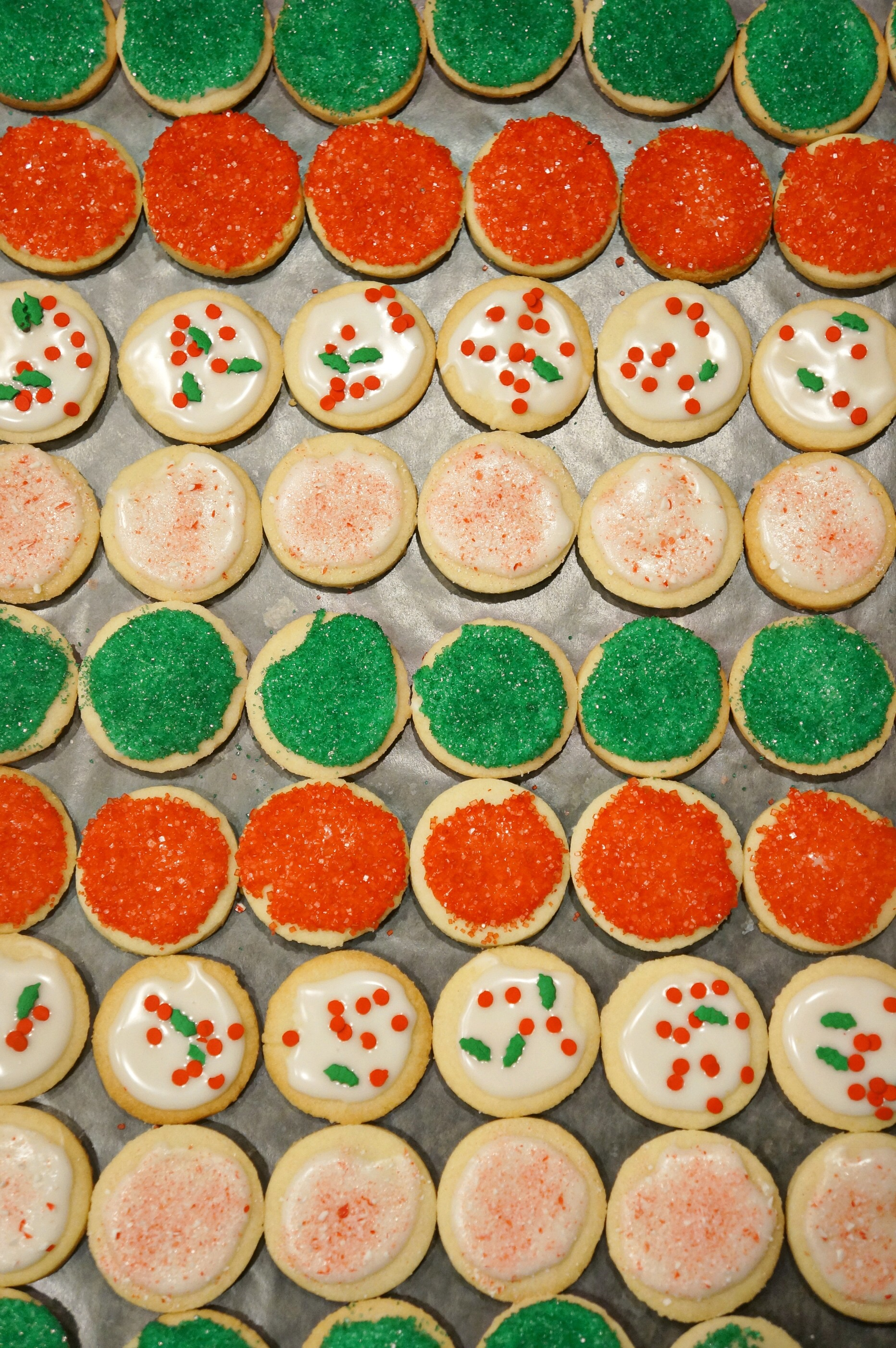 Starting with my cut-out sugar cookies topped with my favorite easy glaze, red sprinkles, green sprinkles, Christmas sprinkles and peppermint crunch.