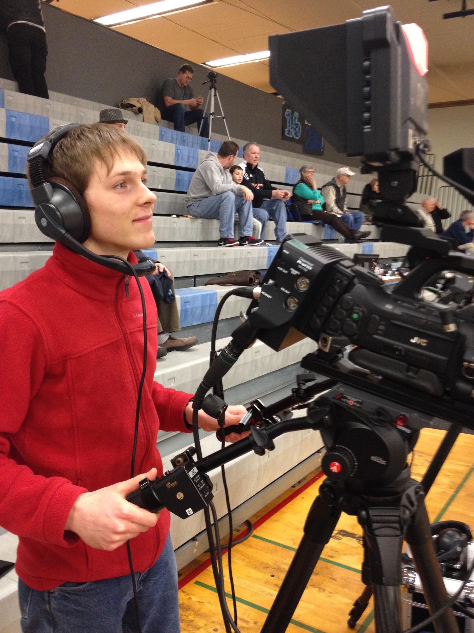 CCTV Volunteer Daniel Beal helps capture a South Salem vs. McNary boys basketball game.