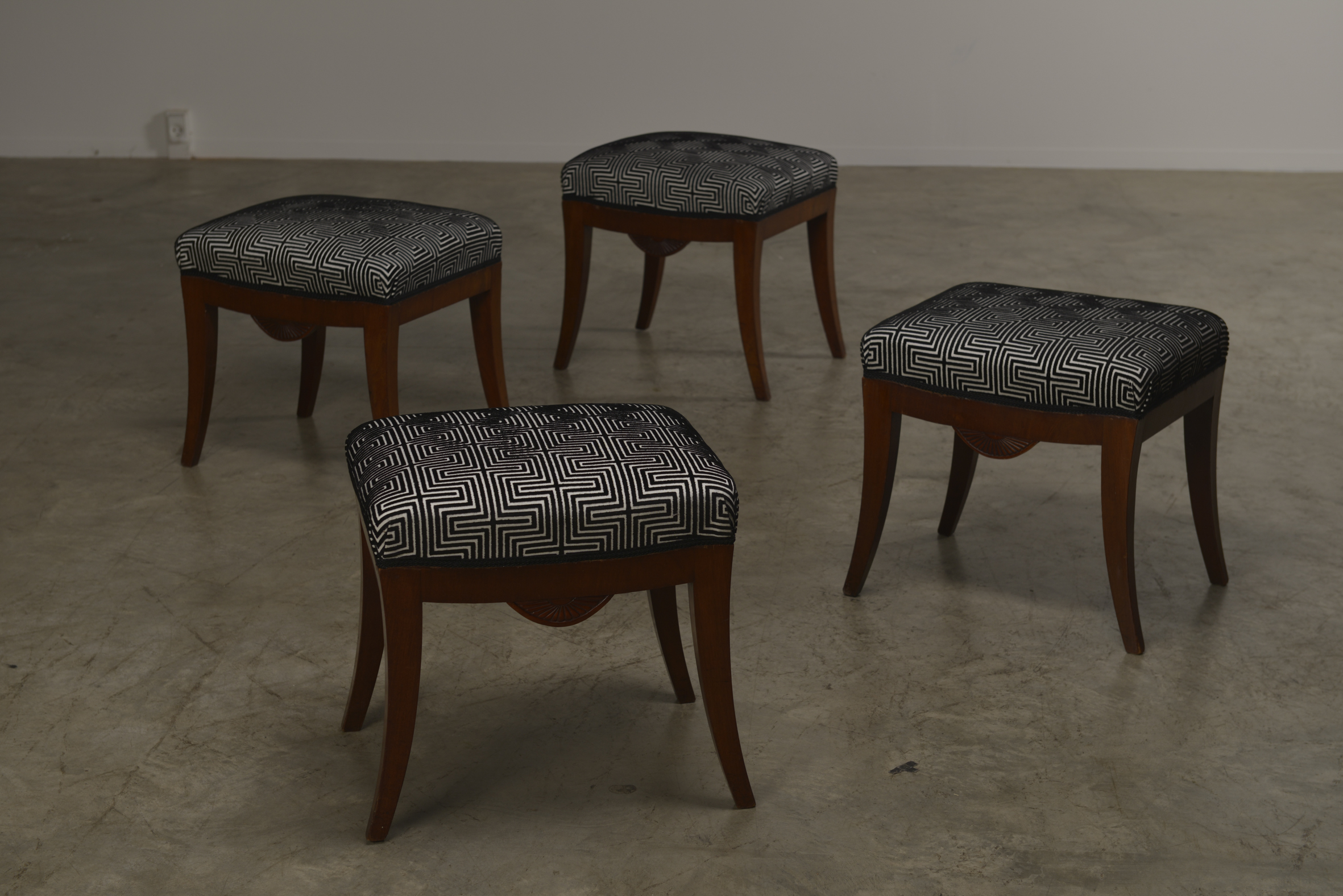 A set of four Swedish Karl Johan mahogany stools, Circa 1830