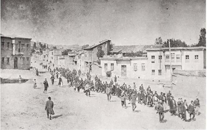 Armenian civilians weremarched by Ottoman soldiers to a prison in Mezzireh (now Elazig) in April 1915. Photo licensed through Wikimedia Commons.