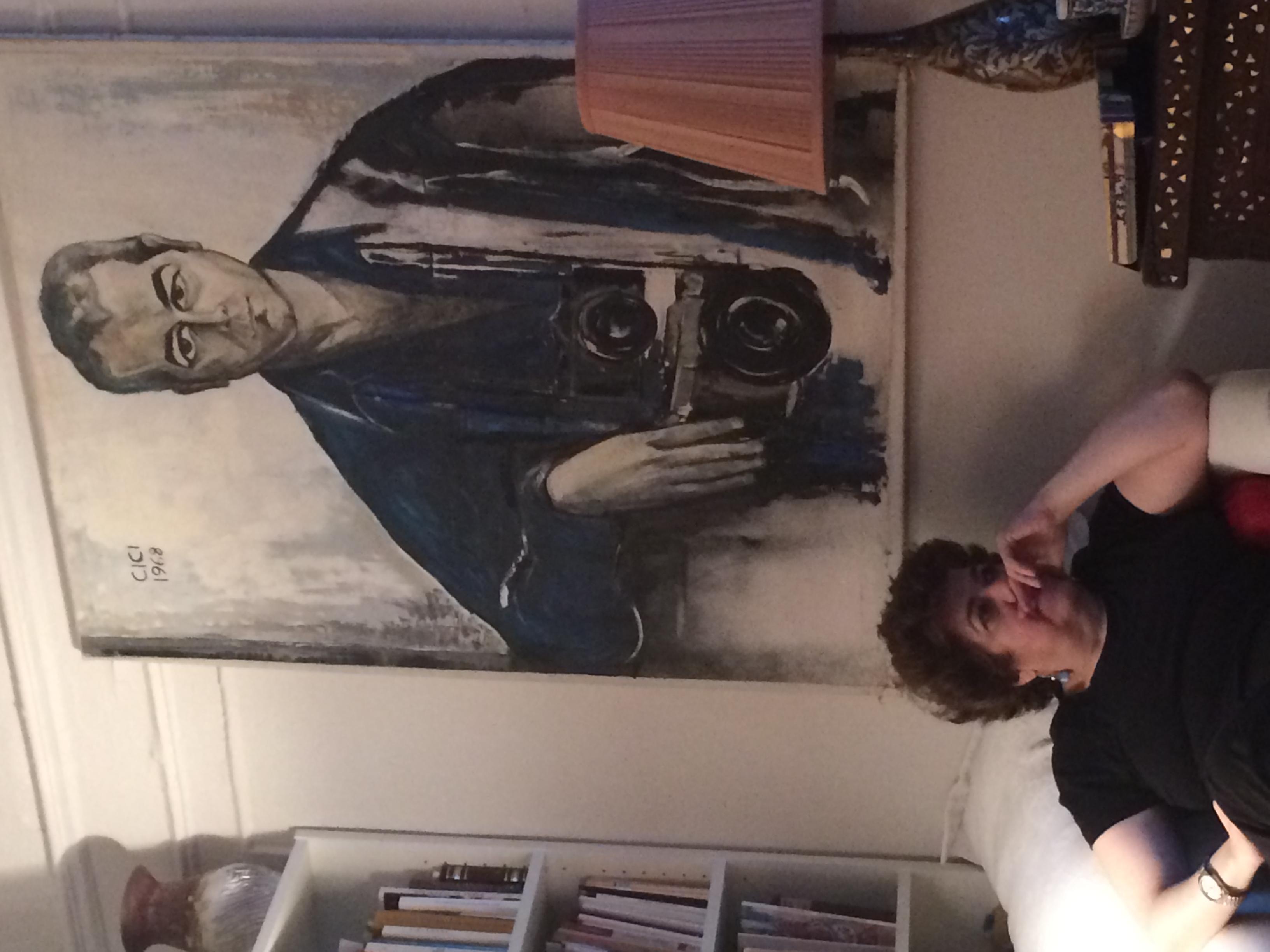 Lola Koundakjian, sits beneath a portrait of her father in her New York City home. Photo courtesy of Koundakjian.