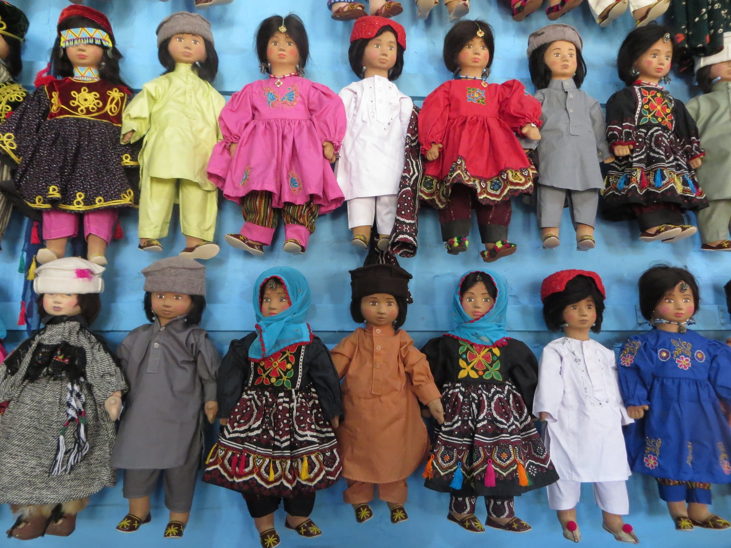 A ROW OF DOLLS DISPLAY THE VARIETY OF TRADITIONAL CLOTHING WORN IN PAKISTAN AT A SHOP OUTSIDE THE RAFIPEER CULTURAL CENTER IN LAHORE. PHOTO BY BEENISH AHMED.