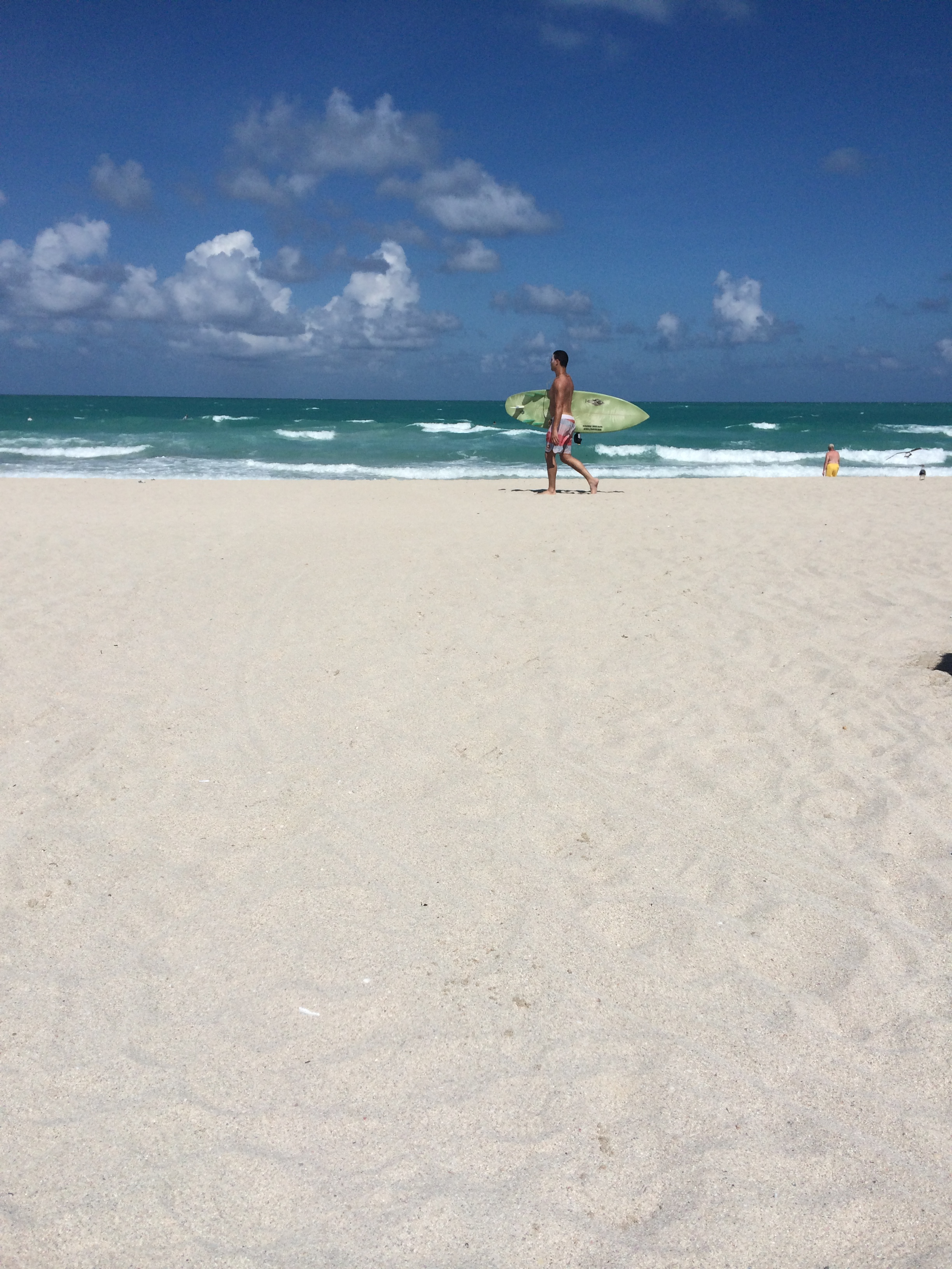 A young man walks along the beach in miami. photo credit: christine amario for the alignist.