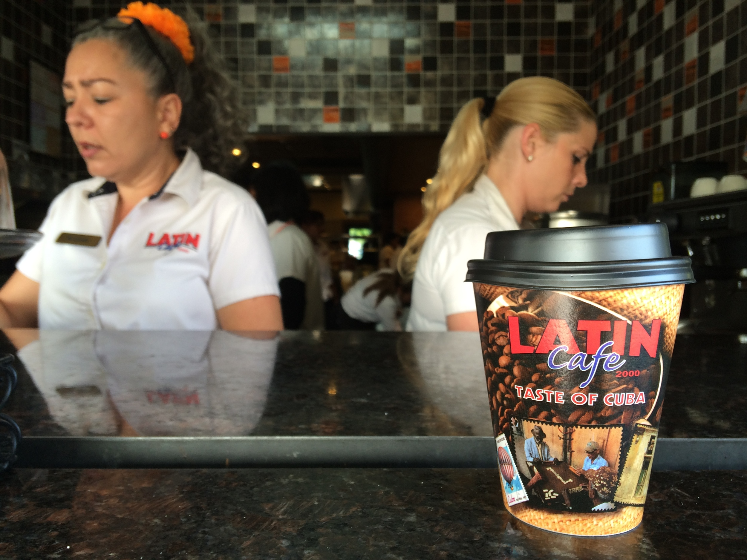"""a miami cafe serves up a """"a taste of cuba"""" to its customers. photo by christine amario for the alignist."""