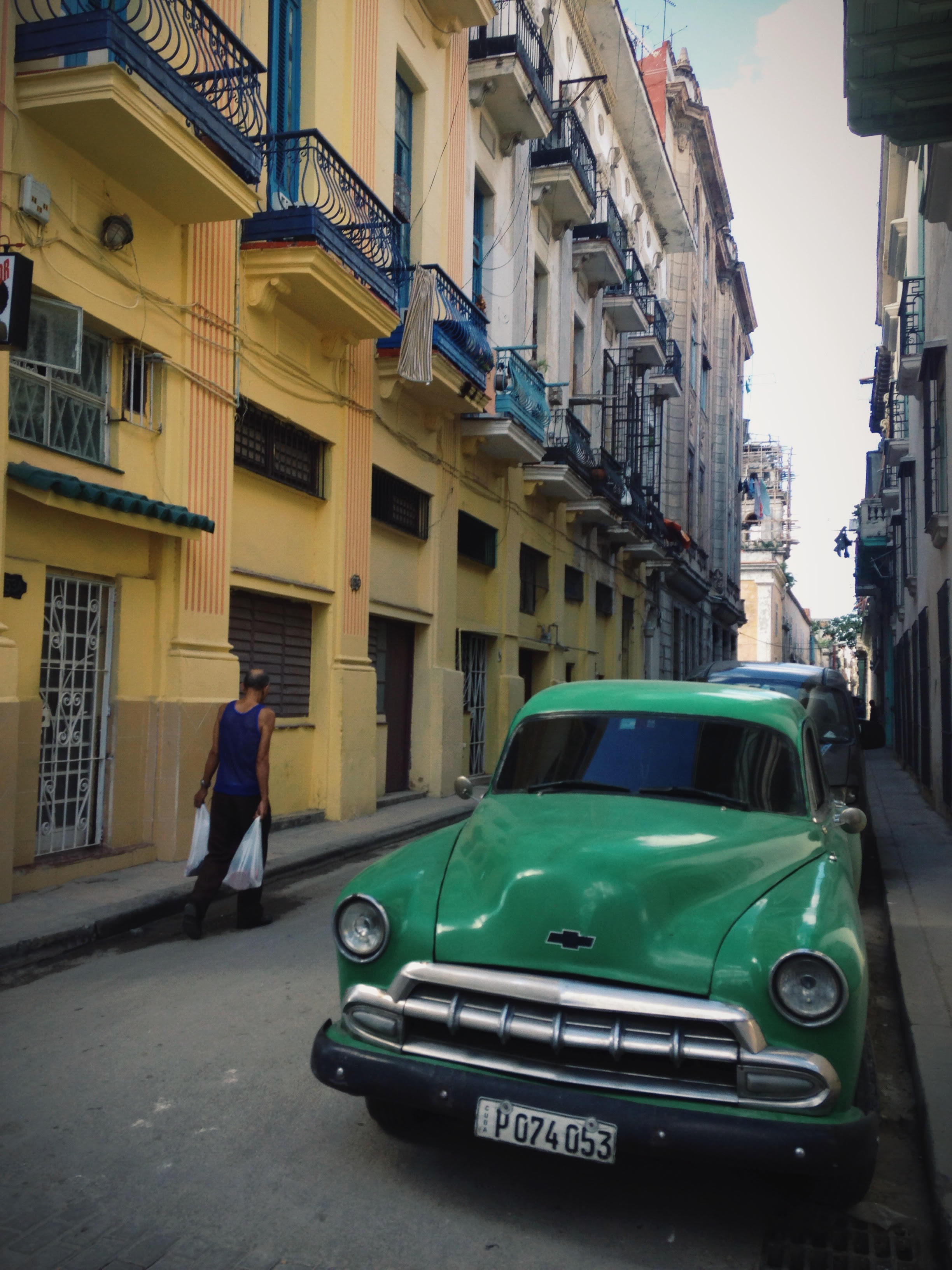 a man walks through havana's streets. photo by meghan dhaliwal for the alignist.