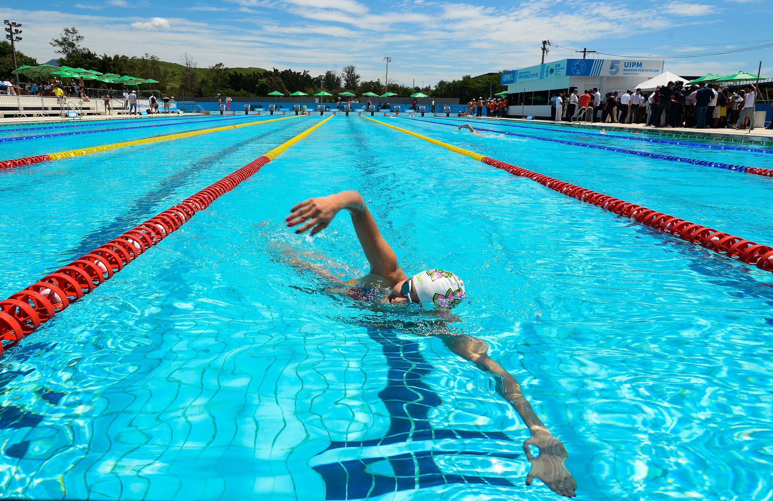 A WOMAN PRACTICES IN THE AQUATICS COMPOUND IN RIO AHEAD OF THE 2016 OLYMPIC GAMES. IMAGE BY TÂNIA RÊGO/AGÊNCIA BRASIL VIA WIKIMEDIA COMMONS.