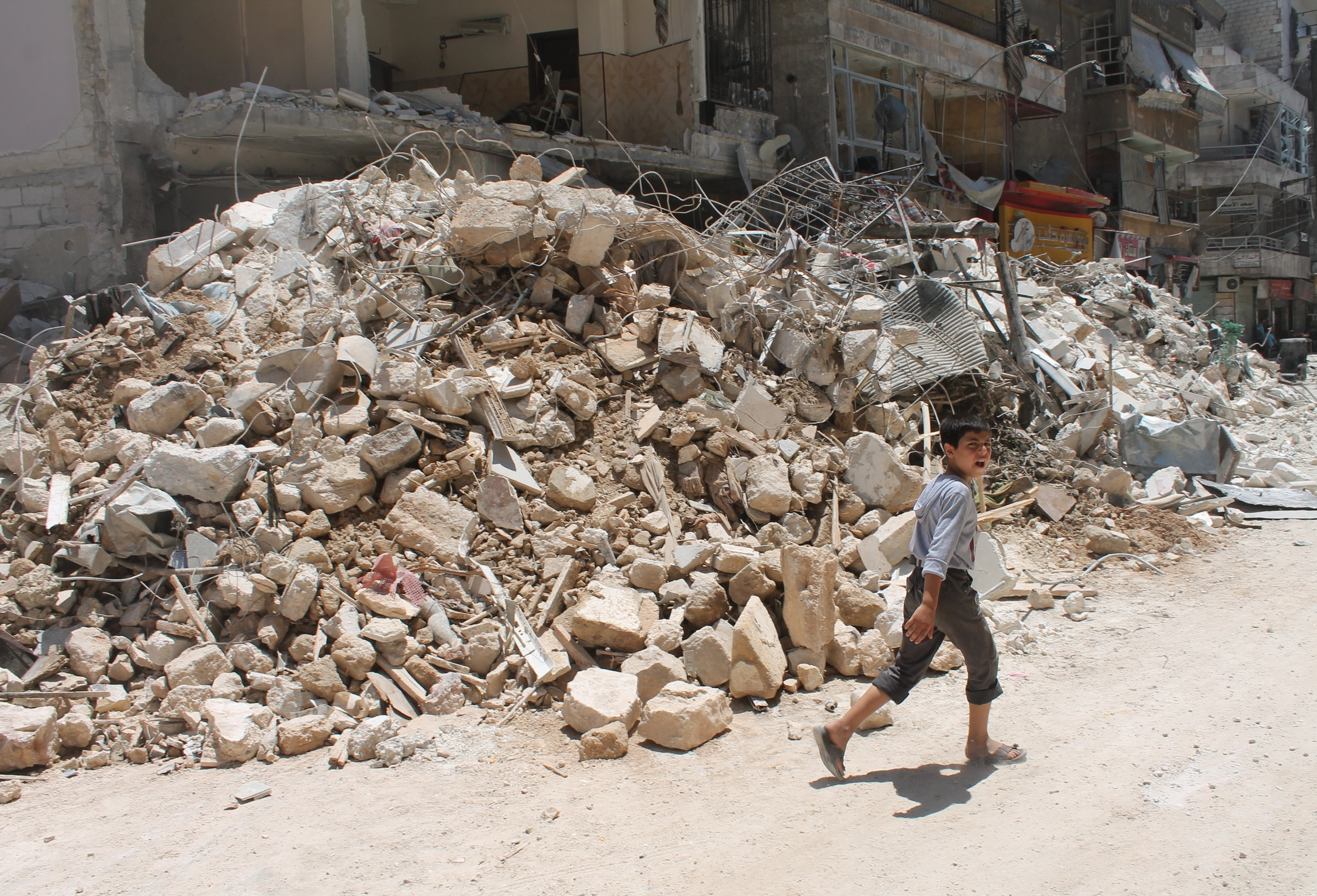 A scene of destruction in Aleppo after it was hit by government airstrikes in 2014. Image by Patrick Hilsman.