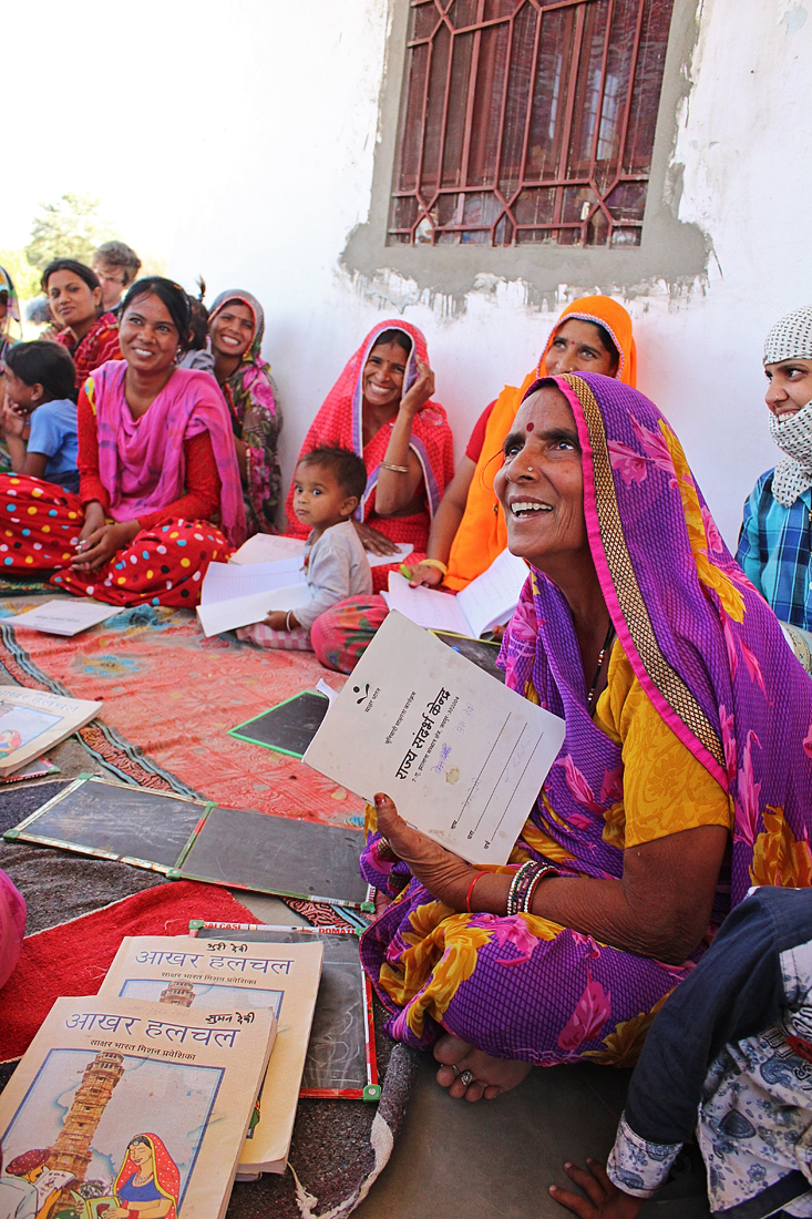 Women artisans attend a literacy workshop in the state of Rajasthan. They have gone from illiteracy, to being able to read newspapers and follow current events.