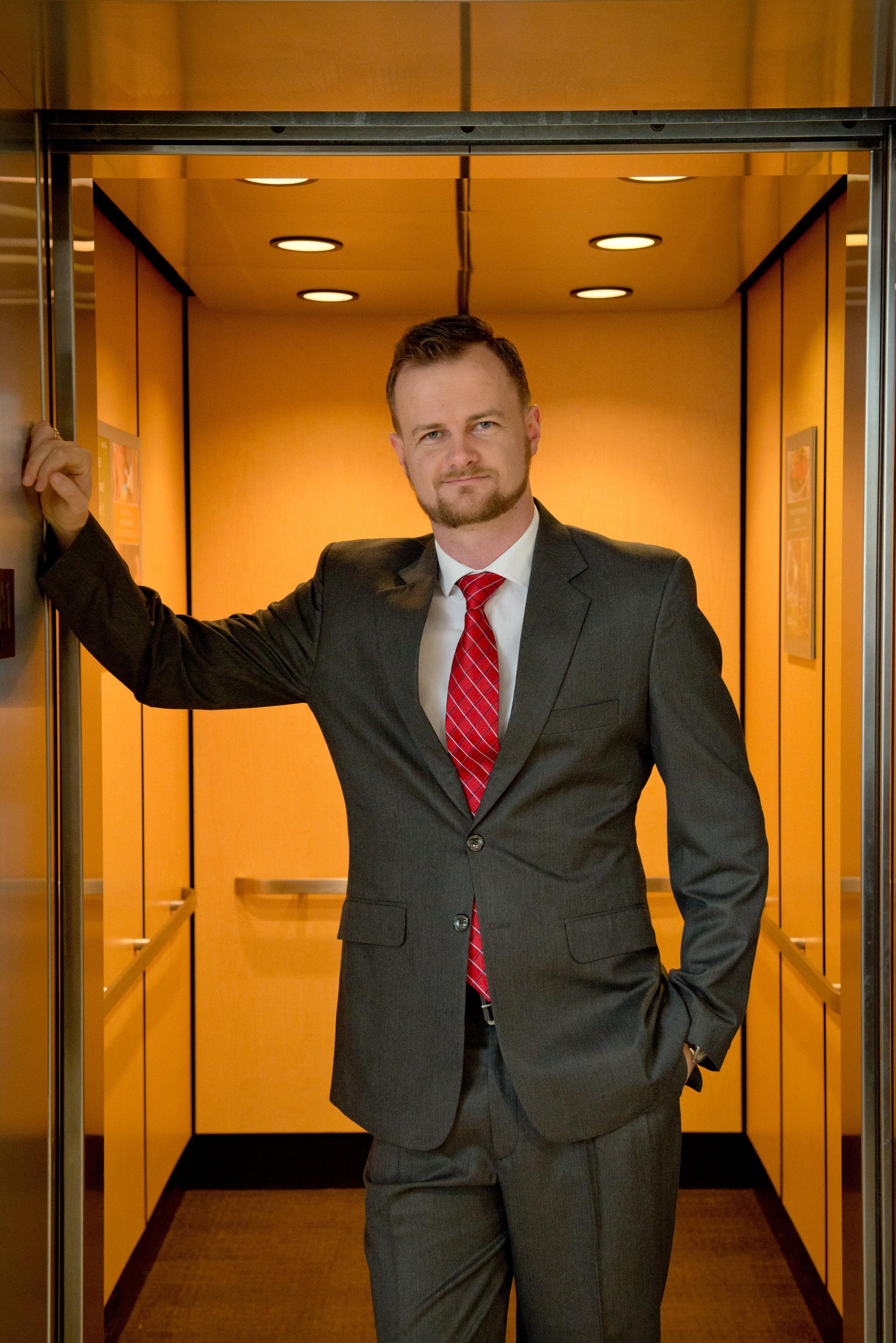 Orlando-senior-guy-elevator-suit.jpg