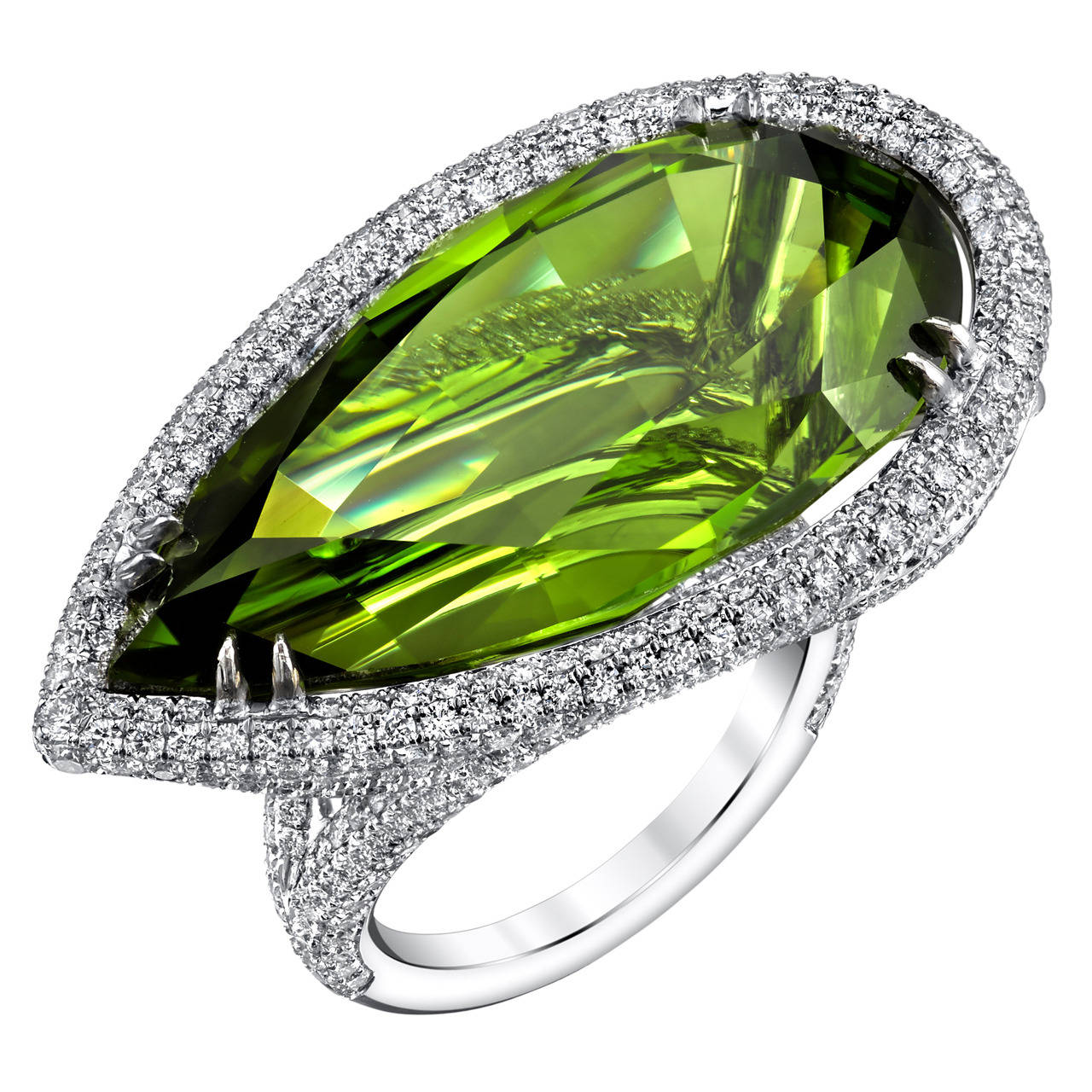 Pear Shaped Pakistani Peridot set in 18 Karat White Gold, accented with Micro Pave Ideal Cut White Diamonds. GIA Certified Center Stone with a Total Weight of 44.30CT. White Diamond Quality G/VS2 with a Total Weight of 4CT.