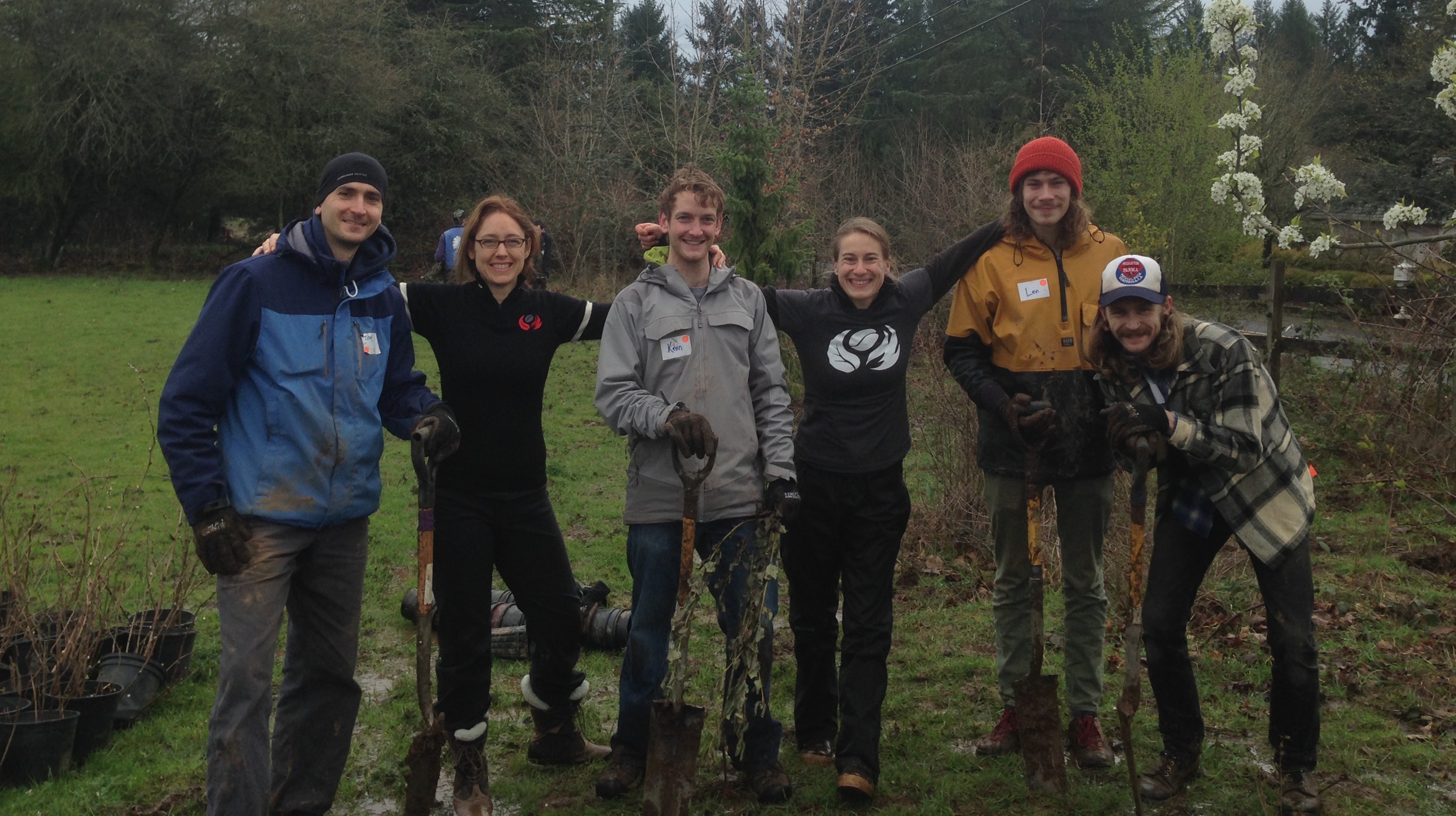 Nossa Familia team members on a staff volunteer day, planting native shrubs on a with Portland non-profit Friends of Trees.