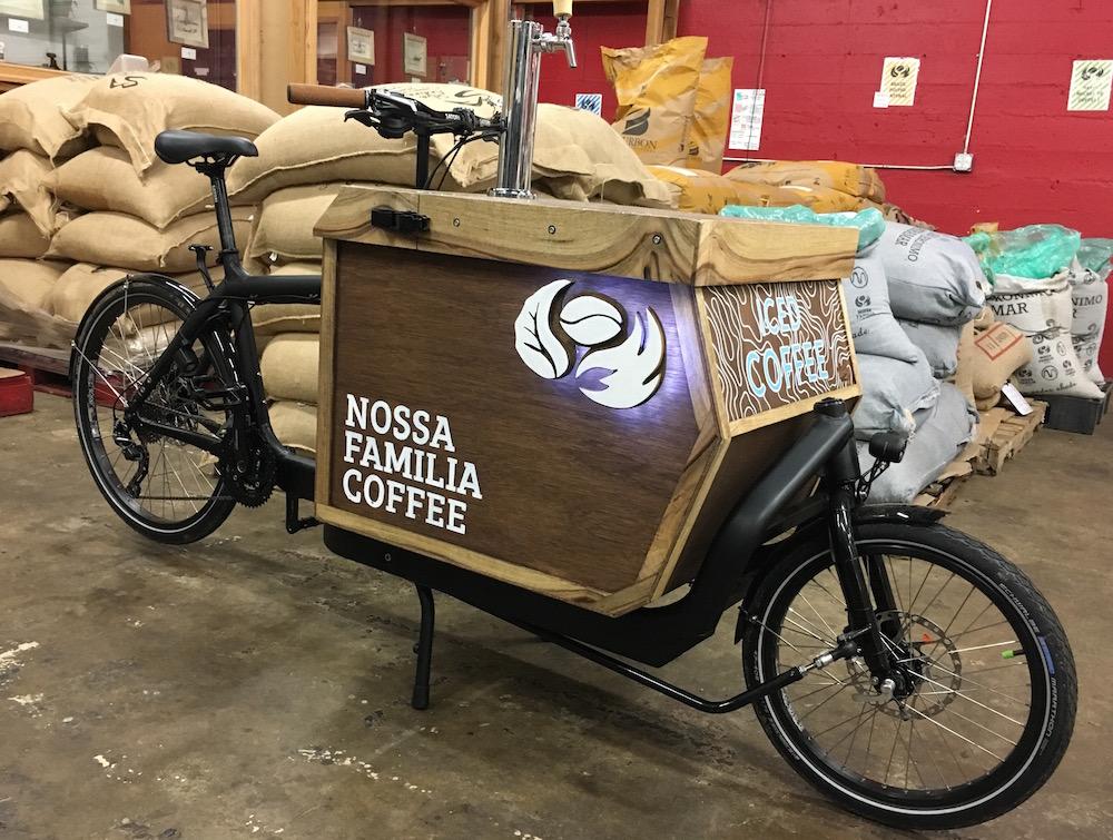 Nossa Familia Coffee's New Iced Coffee Cargo Bike with kegs on tap