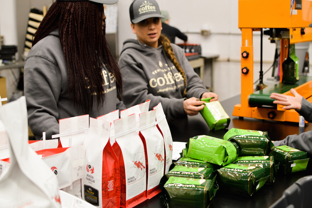 Central City Coffee trainees work alongside Nossa Familia Coffee production employees at the Nossa Familia roastery in Portland, Oregon.