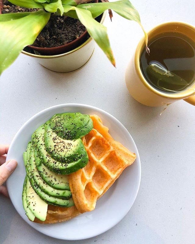 Saturday plans? Heading to our Central Eastside Café for one of these Avocado Cheese Waffles!🥑🧀 Thanks @tablejustforone for the inspiration (and making us hungry!) - • AVOCADO CHEESE WAFFLE 🥑 •  Move over, avo toast—there's a new avocado breakfast item in town 😎 The Nossa Familia Coffee by my work makes a version of pão de queijo—that delicious Brazilian cheese bread 🇧🇷 🧀 Their cheese waffle is gluten free (which I personally don't care about but I figured you guys might!) and quite cheesy! They're rather tasty on their own but if you wanna #treatyoself, add on a little avocado for some extra decadence. Make sure to eat these hot out of the waffle iron so they're nice and crispy—they get a little gummy (the starch!) when they cool down a bit.  P.S. That is not my plant 🌱 ; it is the random kitchen plant at work that no one waters apparently. Don't @ me about dem yellowing leaves 😆  Repost via @tablejustforone