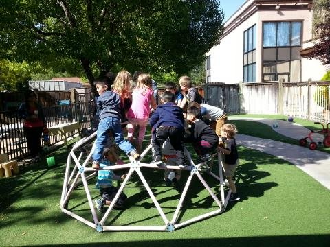 Pictured: Older 3's and 4's enjoying the play equipment