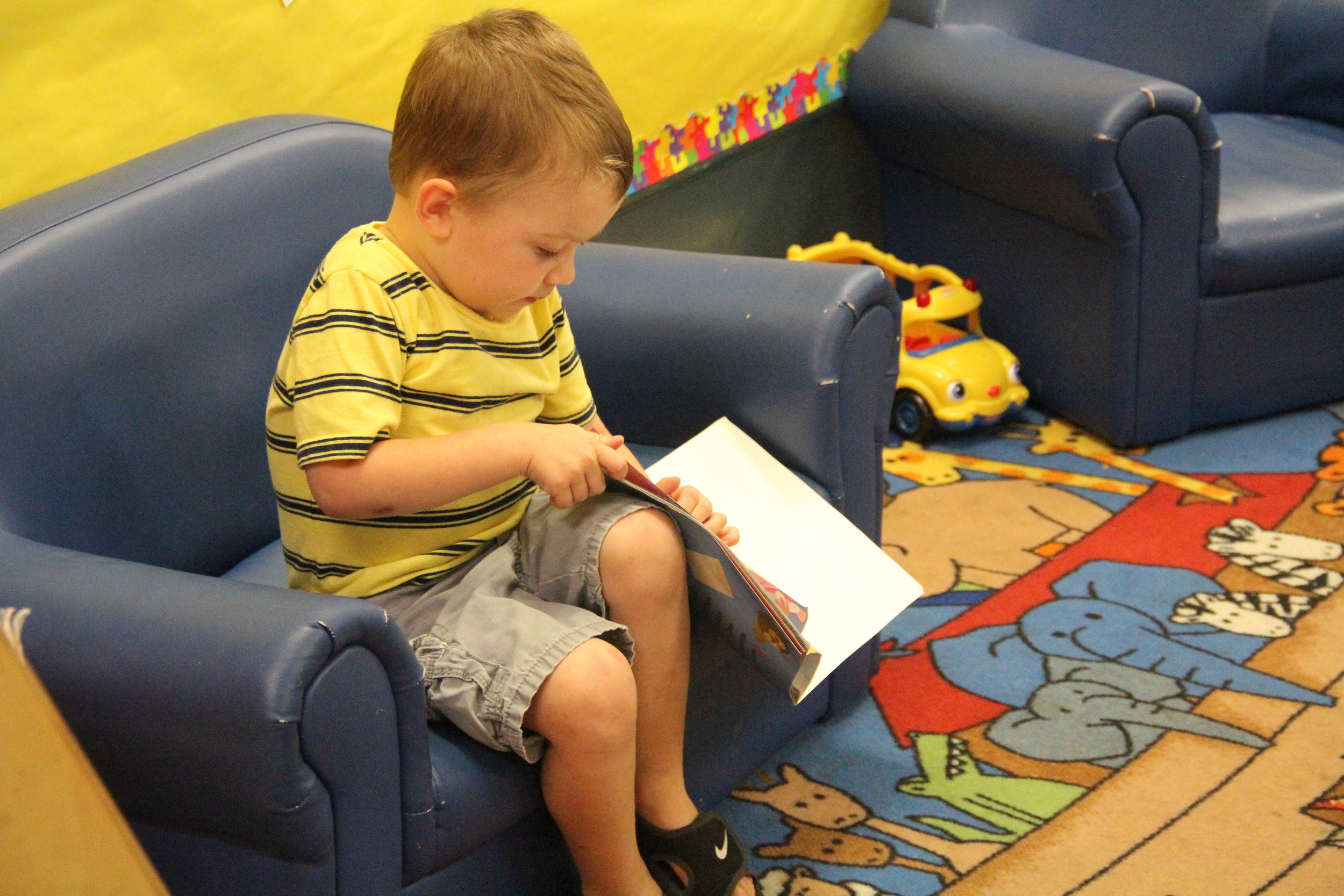 We encourage all of our kids to read! We start early by using picture books and a comfortable environment to encourage this lifelong skill.