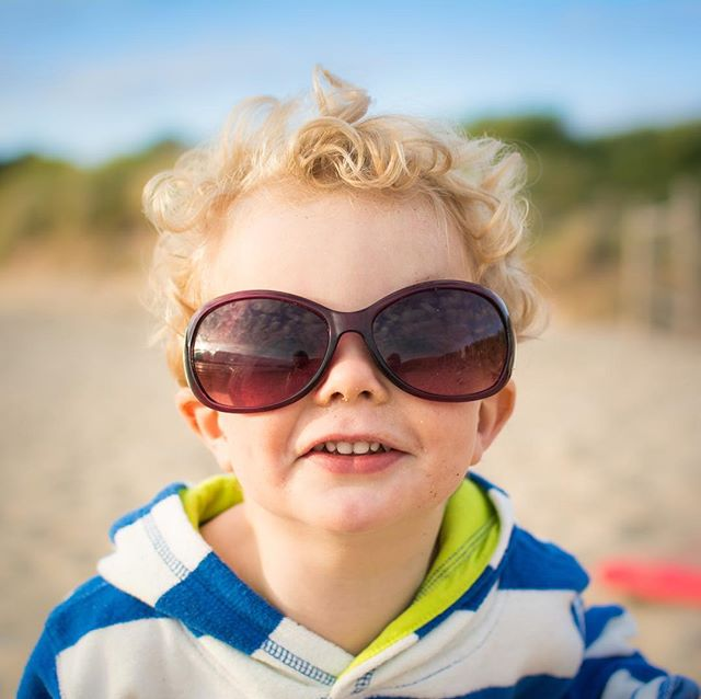 Love a portrait of a kid in adult 🕶! • • • • • #magicofchildhood#clickinmoms#letthekids#candidchildhood#childhoodunplugged#cameramama#childrenofinstagram#naturallightphotography #rosiewedderburnphotography #familyphotographer#portrait  #theportraitcollective #makeportraits#portrai_ig#abmsummer#documentyourdays#sunglasses#microfashion