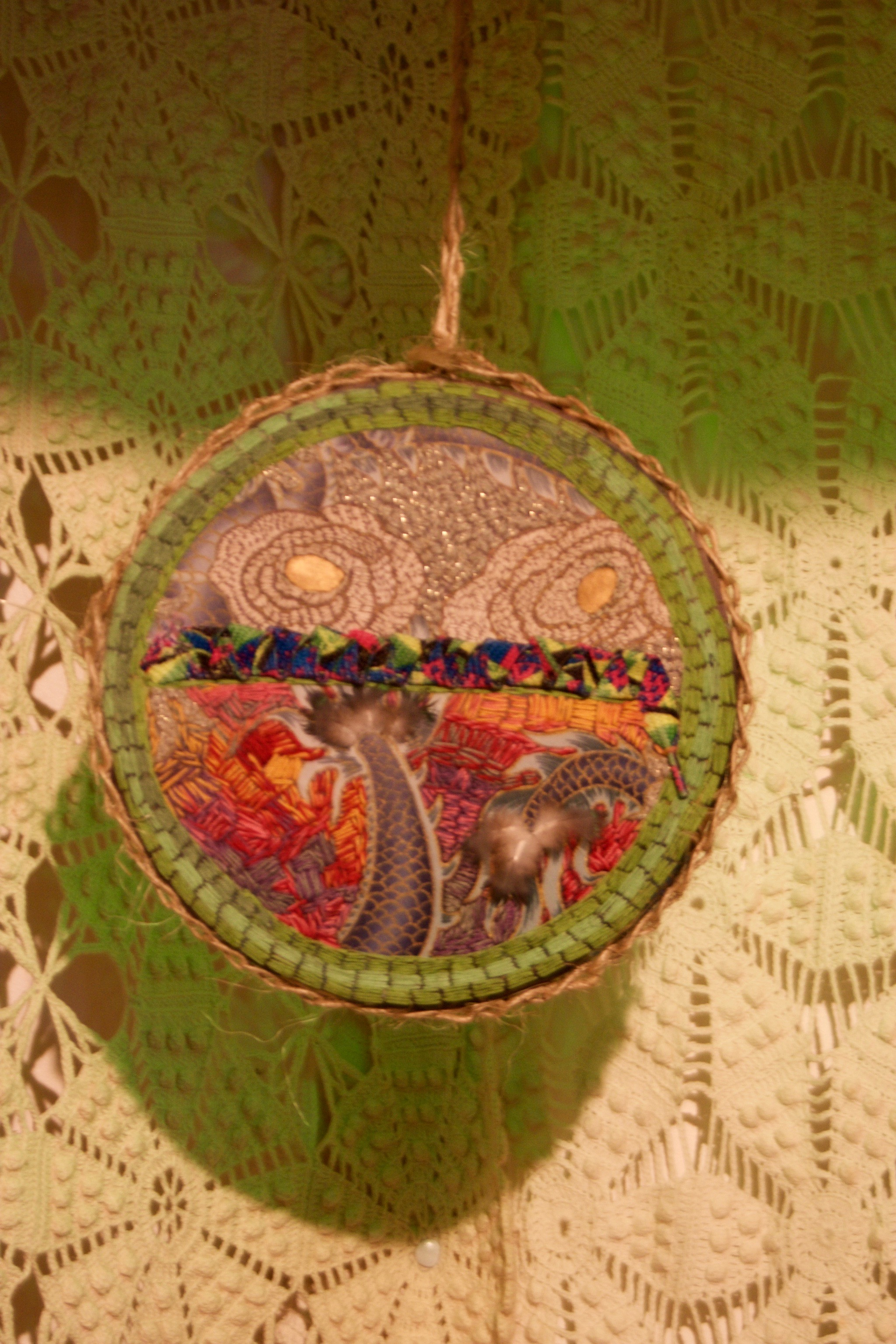 Equivalents , embroidery with feathers, shoelaces, and twine, 8 1/2 x 8 1/2 inches