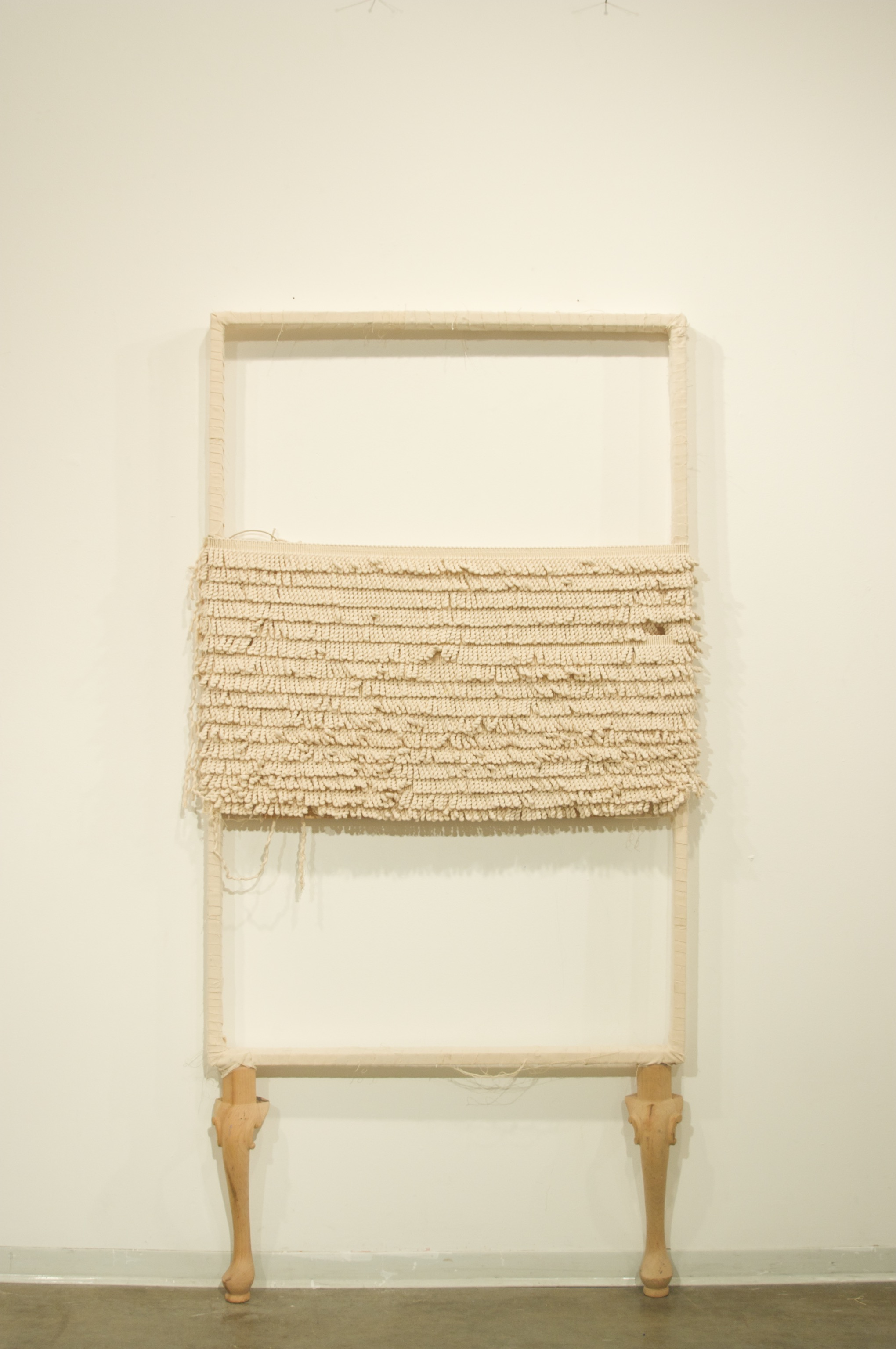 The Last Painting , canvas with cotton trim, and found wooden legs, 33 x 69 inches