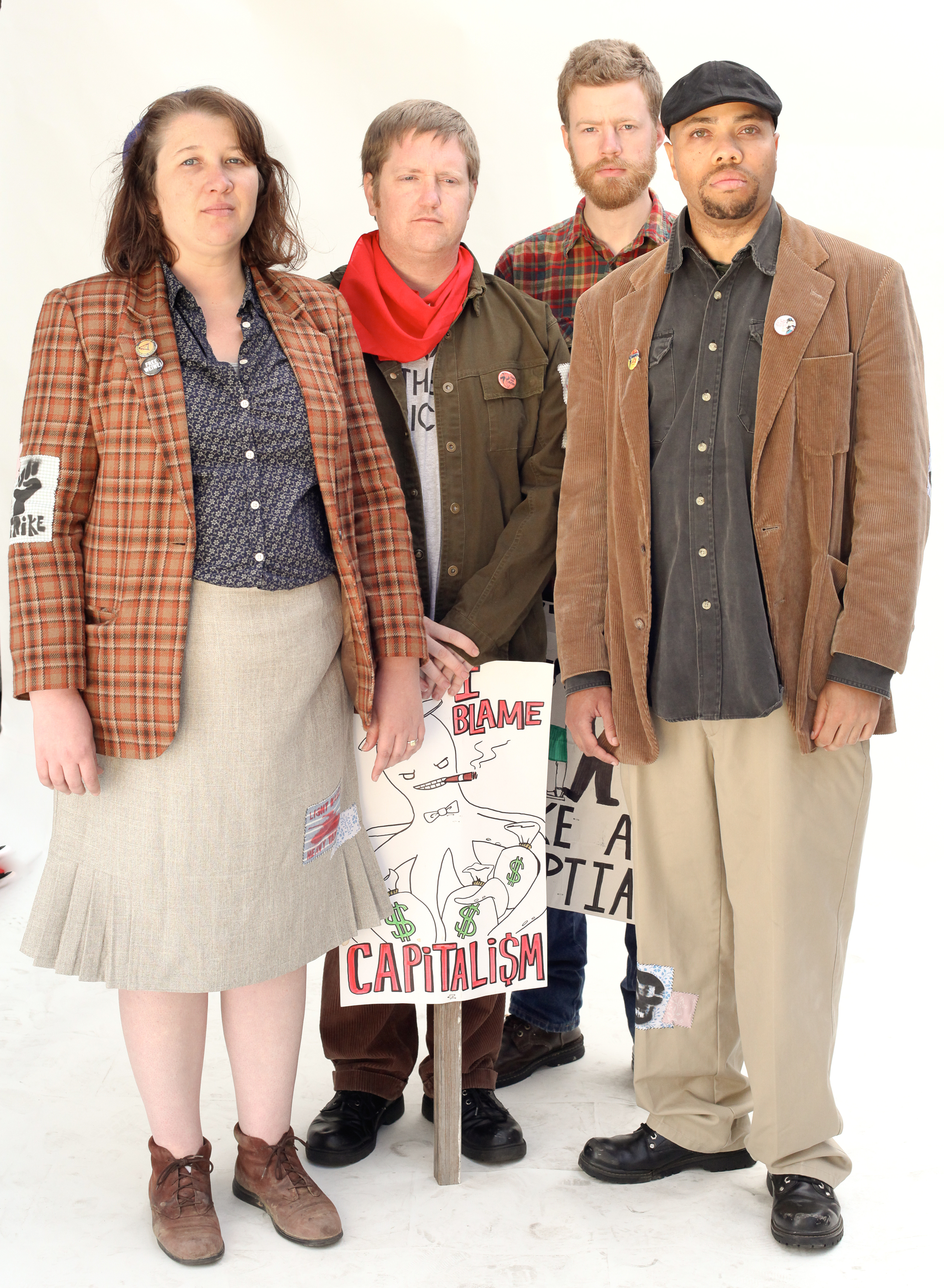 Members of A4DS posing for their portrait in  Class War Store