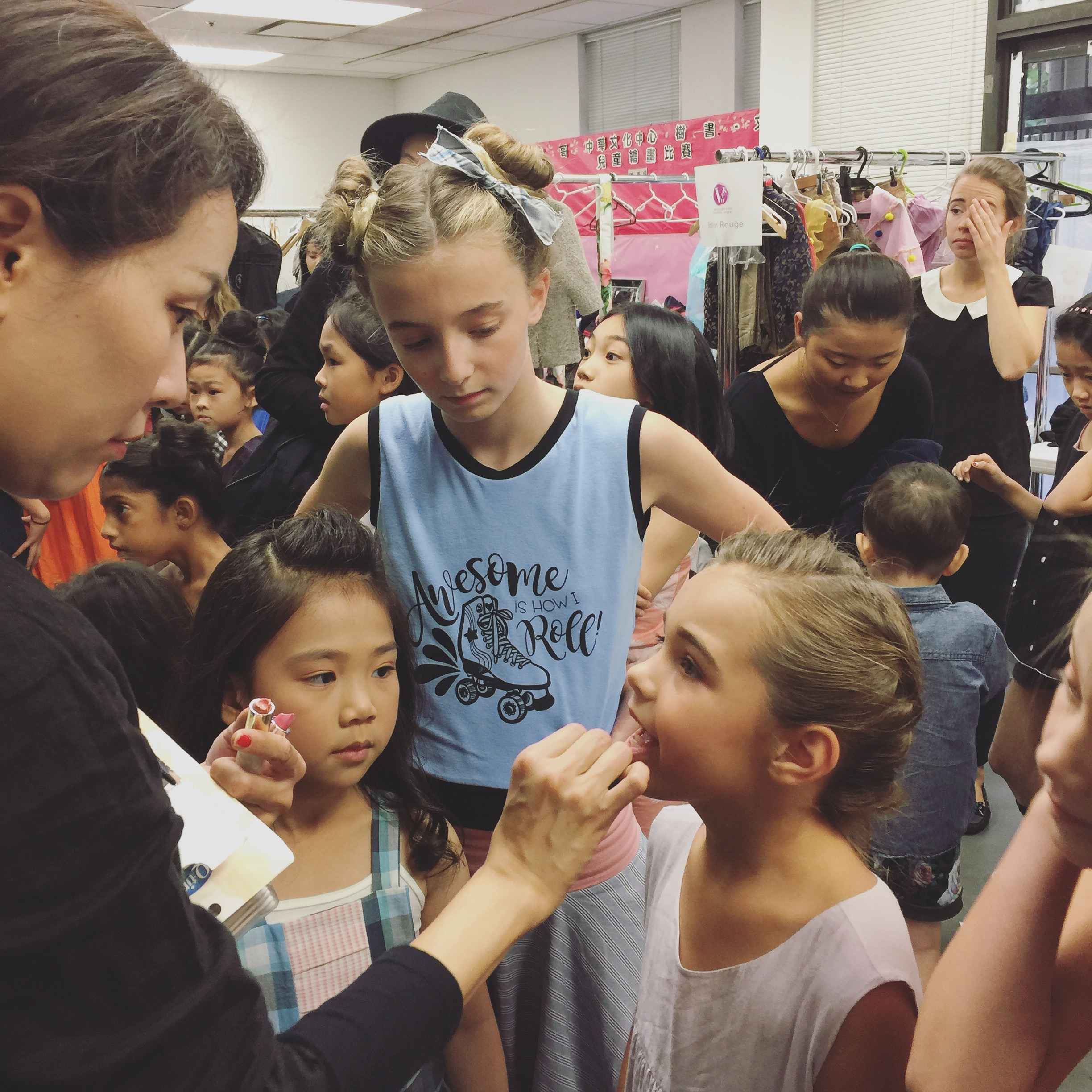 Models getting last minute make up touch ups before hitting the cat walk