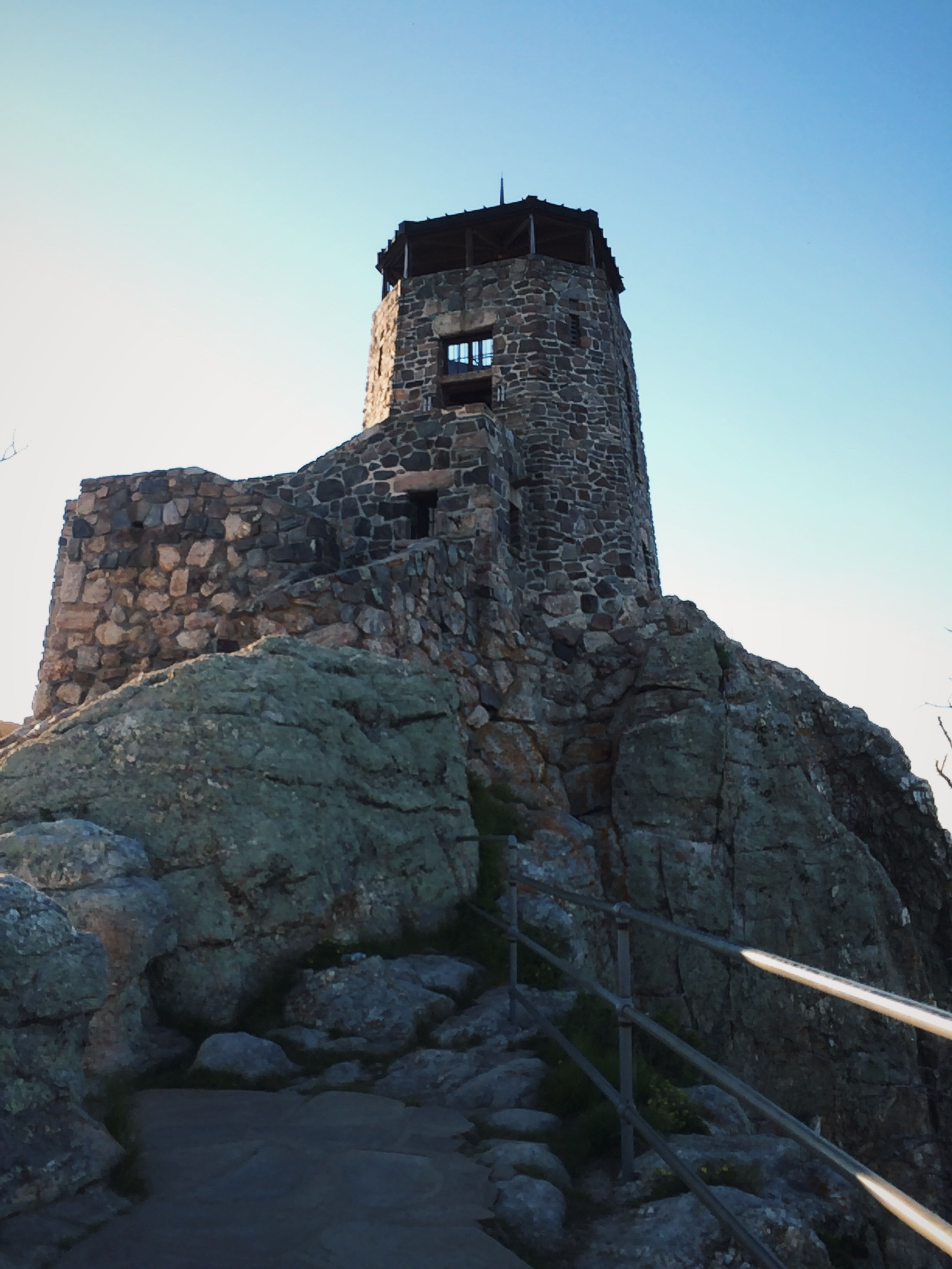 At the top of Harney Peak. The Civilian Conservation Corps finished the fire tower in 1938.