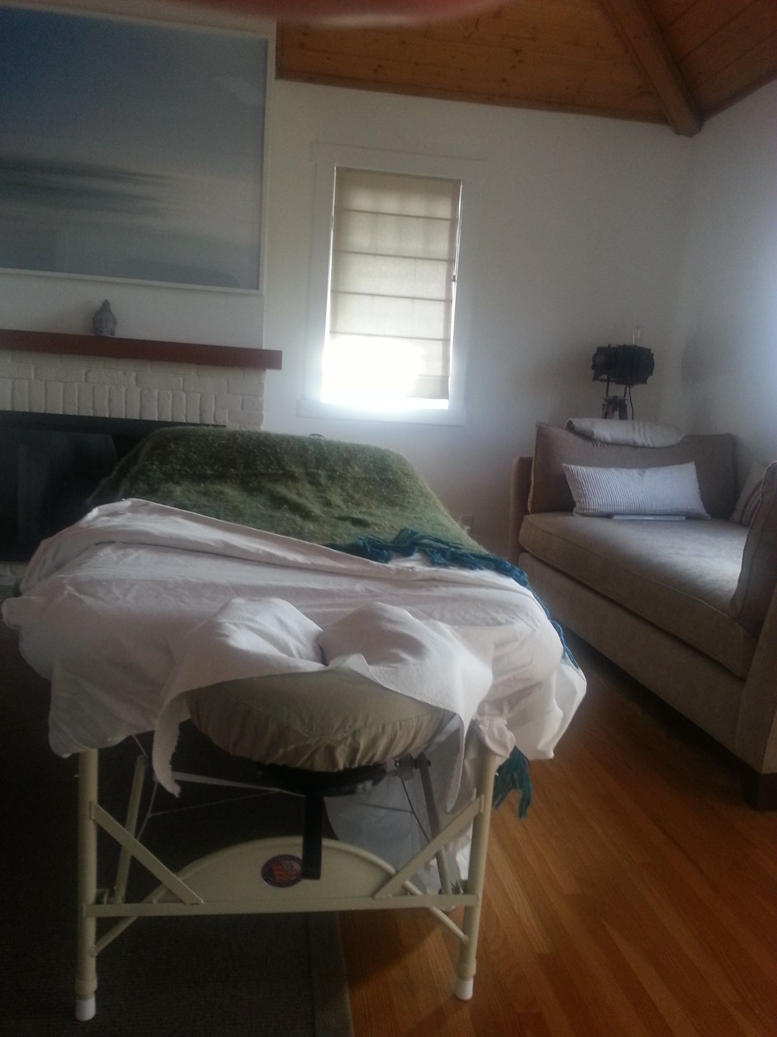 Natural light provides a nice ambiance for this mobile massage set-up at the home of a regular client in Venice.