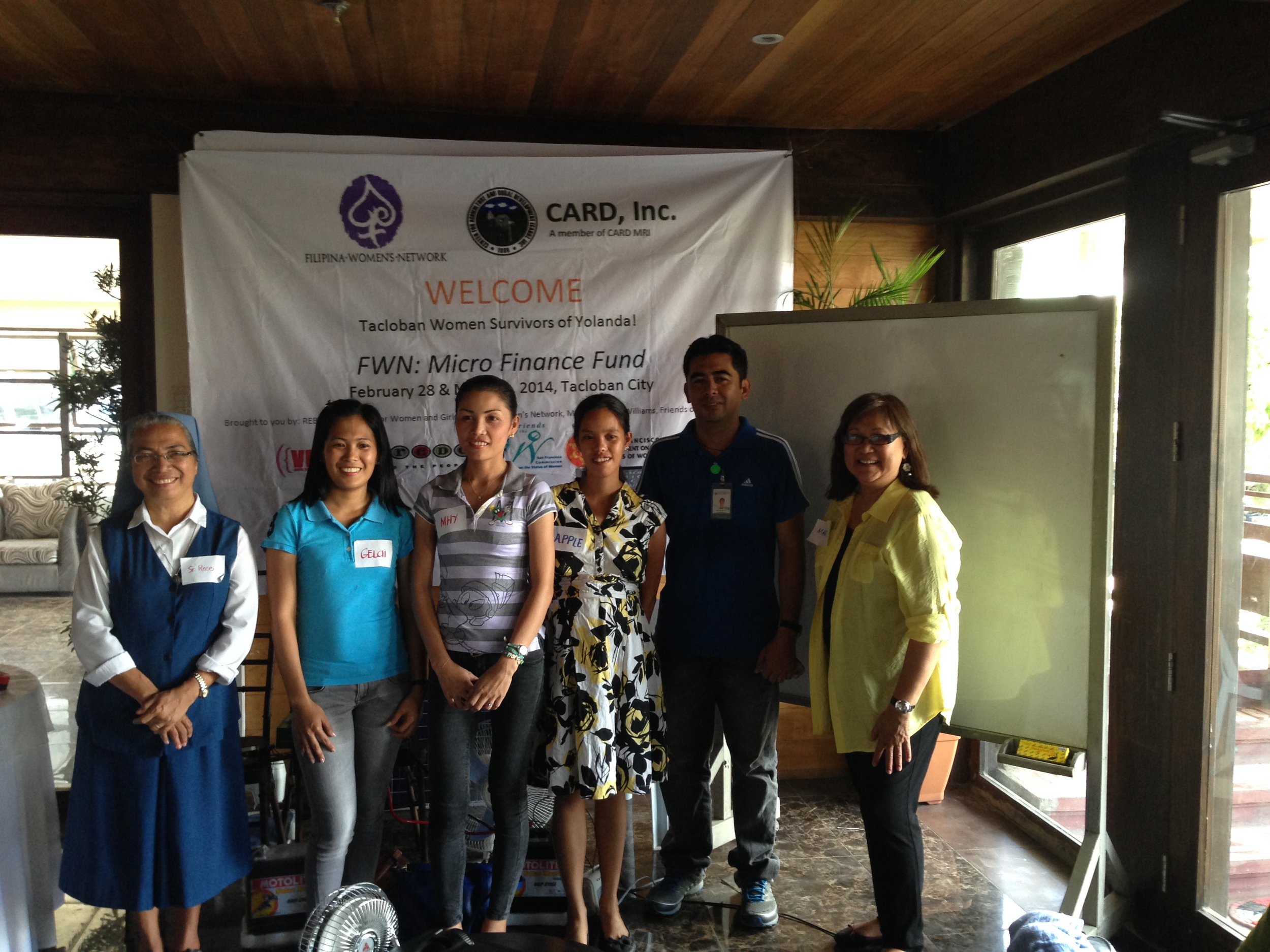Sister Rose Ongcoy, Mother Superior of the Pauline Sisters Tacloban (left) with the Trainers of MRI CARD INC. who explained the Micro Finance Loan Application, Approval and Repayment Process to the Women of Tacloban with Marily Mondejar, Founder & CEO, Filipina Women's Network.