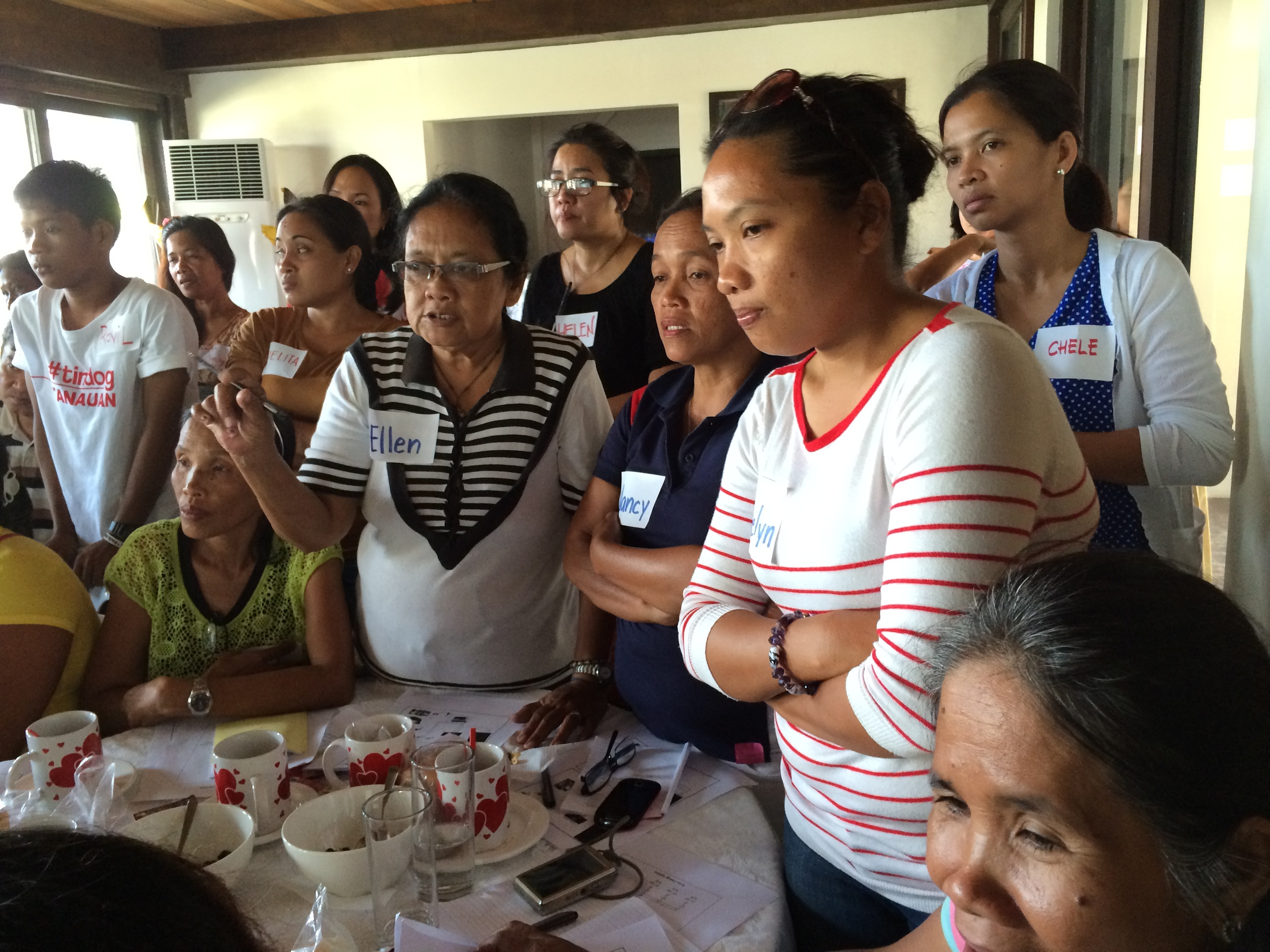 Tacloban City Women Survivors during job training intently listening to the program details.