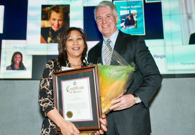 San Francisco District Attorney George Gascon (right) presents the Certificate of Honor toTessie Guillermo (FWN100 '07) during Women's History Month ceremonies in 2013.