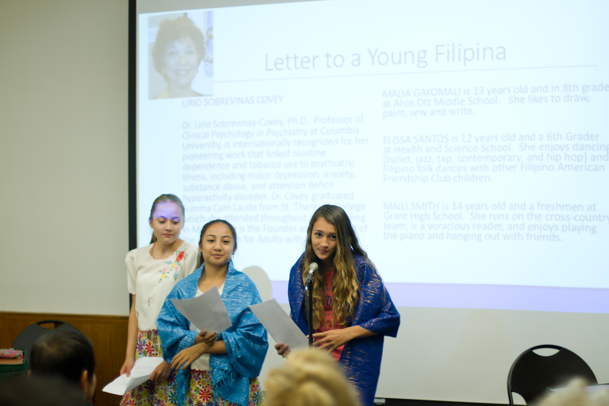 Malia Gayomali, Elissa Santos, and Maili Smith read Letter to a Young Filipina by Lirio Sobrevinas Covey.