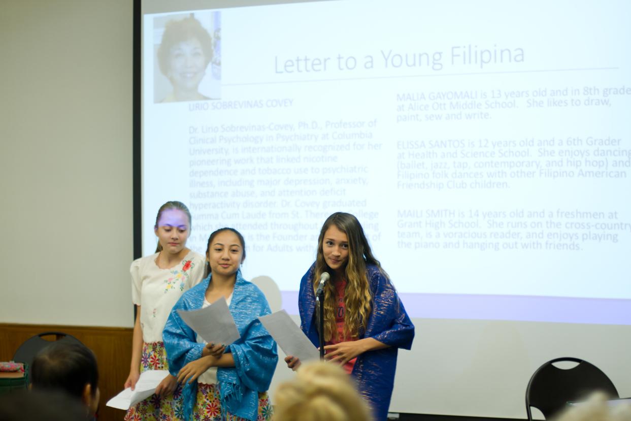 Malia Gayomali, Elissa Santos, and Maili Smith read Letter to a Young Filipina by Lirio Sobrevinas Covey.