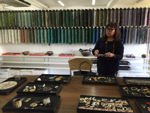 Marily Mondejar in the Material Library of the R&D Department at Kor Landa, pictured with a colorful assortment of precious and semi-precious stones, beads, shells and samples from the upcoming 2017 collections of Kor Landa's three in-house brands: Nature, Franck Herval and Ori Tao. Over 700,00 pieces of jewelry are produced at Kor Landa each year.