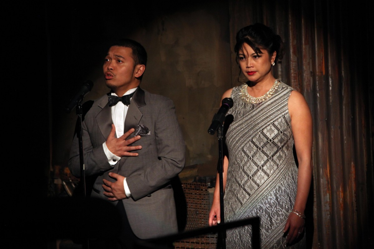 Nestor (Melvign Badiola) and Barbara (Esperanza Catubig)voice their the ever-popular radio play. Photo by Jennifer Reiley.© Magic Theatre. All rights reserved.