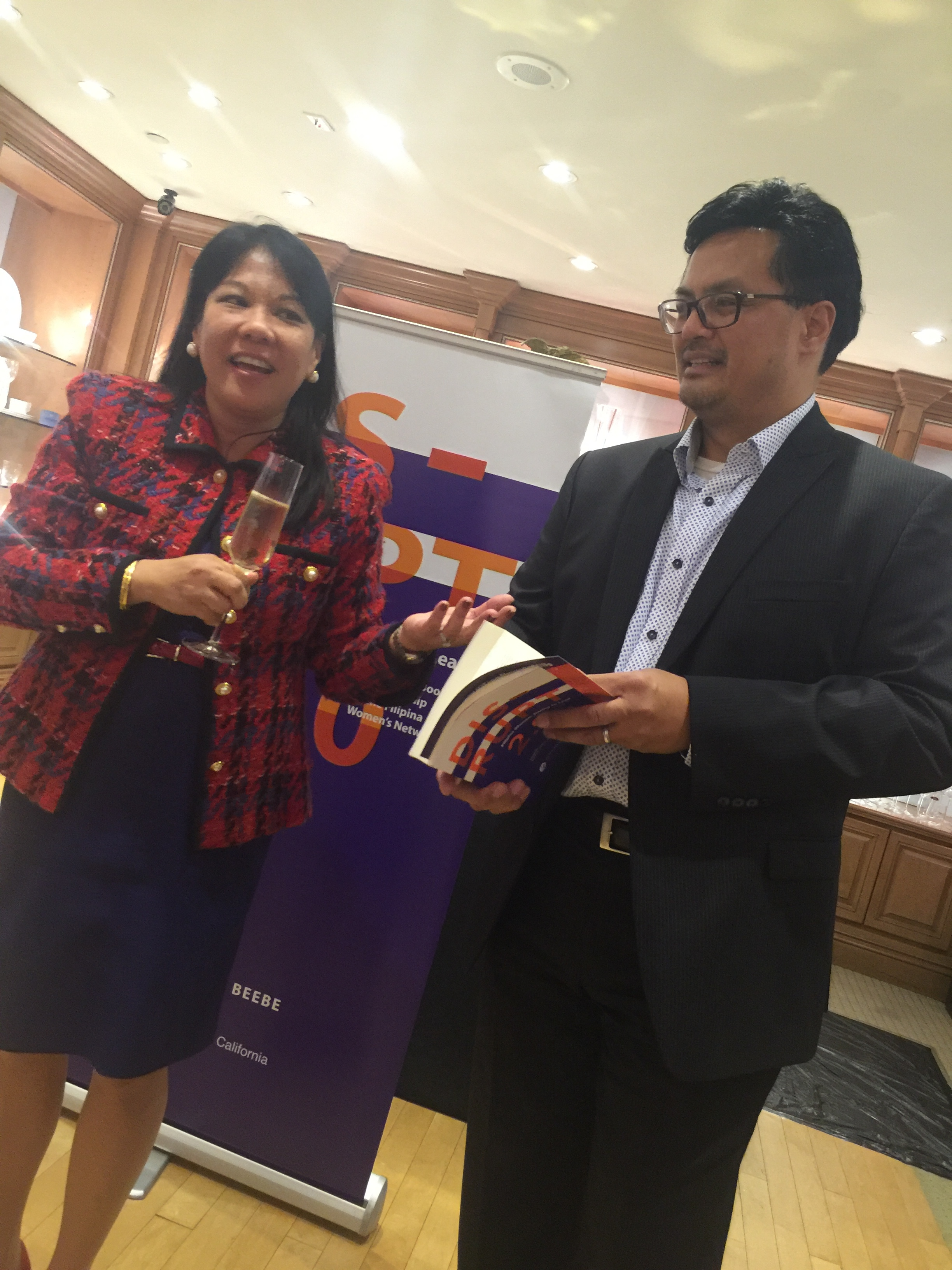 """Vasquez & Co. Partner Benel Se-Liban (U.S. FWN100™ '11) and her husband L.A. Board of Transportation Commissioner Dr. Cris Liban read from their chapter """"A Life That Matters"""" in  DISRUPT 2.0: Filipina Women: Daring to Lead at DISRUPTing Beverly Hills. Benel chaired the event."""
