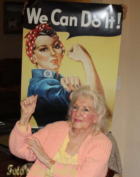 Naomi Parker Fraley poses in 2015 with the iconic Rosie the Riveter poster that became a feminist touchstone. Photo credit:John D. Fraley
