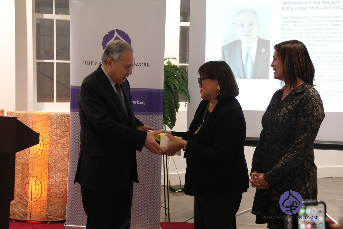 Ambassador Jose Manuel G. Romualdez receives copies of the DISRUPT book series from FWN CEO and Founder Marily Mondejar and FWN President Susie Quesada after he delivered opening remarks at the book launch of Disrupt 3.0 at the Philippine Embassy on 28 March 2019.