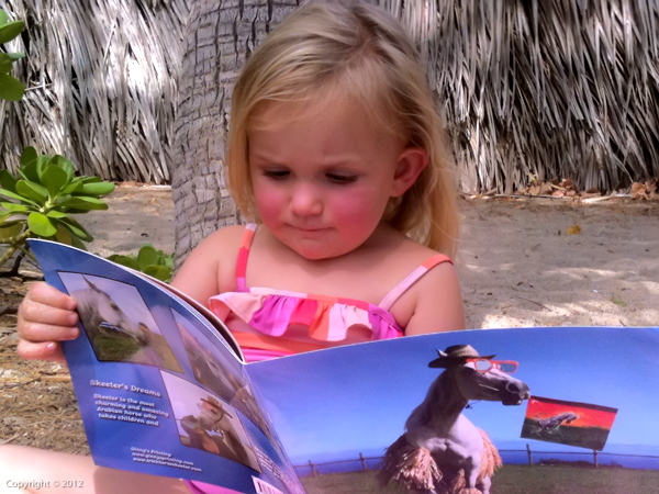 Hoku (the little girl who inspired the book) Reading  Skeeter's Dreams