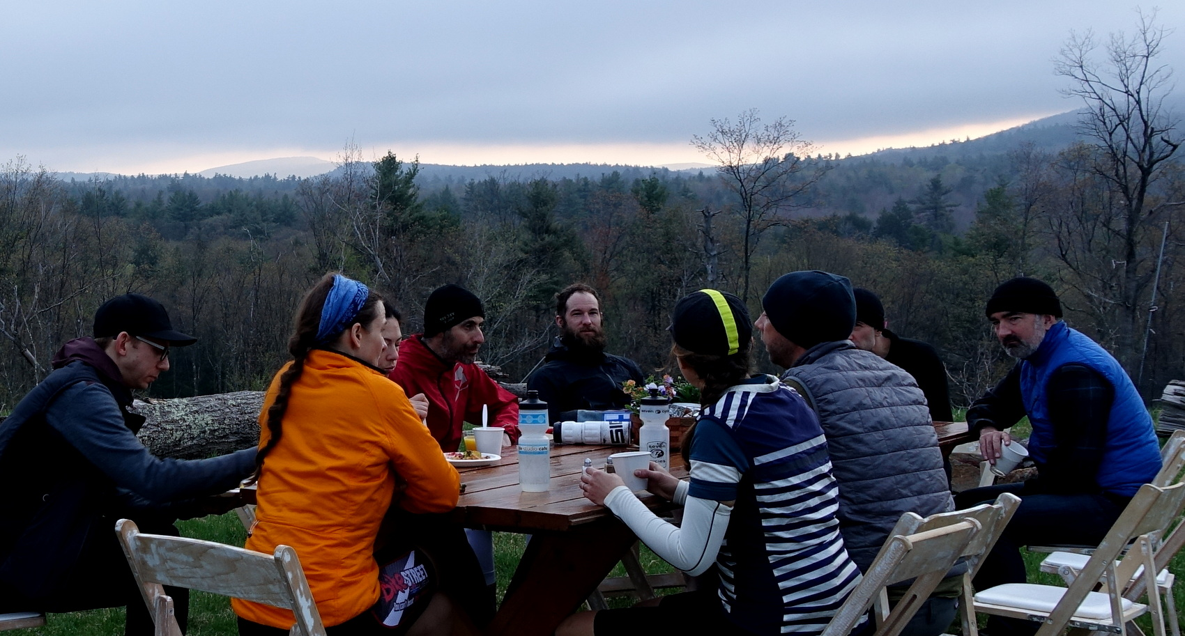Strategy Before Sunrise : Some of the Manehars discuss the day's plan during the 5:00 am breakfast.