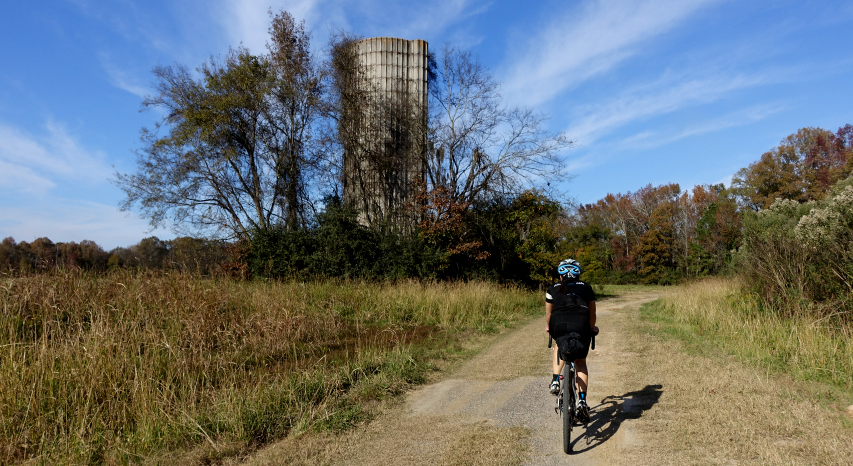 Here's one of the transition points between stunning singletrack to more dirt road. An abandoned silo stands watch over our group.