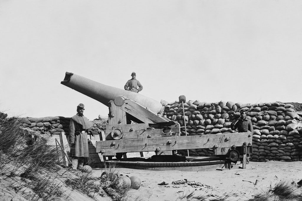 Union Soldiers stand by a Confederate Gun after the Fort's Capture; note the cannon's shattered muzzle.