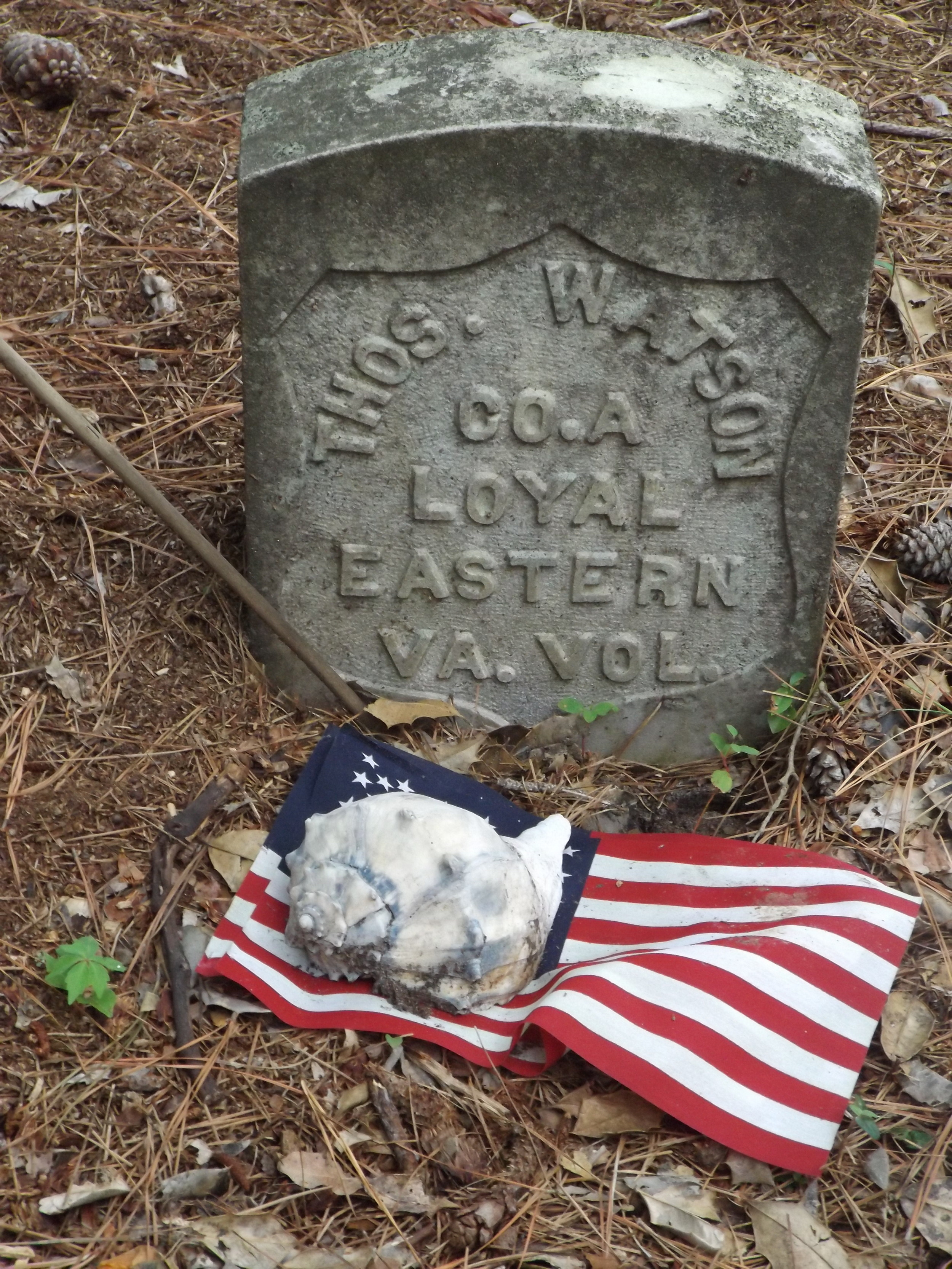 One of the few headstones still standing in the cemetery, the grave of Thomas Watson reveals the island's Civil War past.