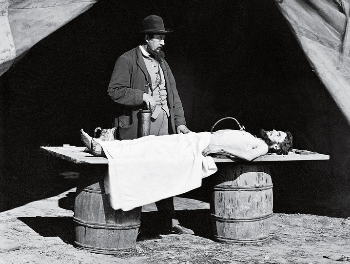 Dr. Richard Burr at work in his embalming tent