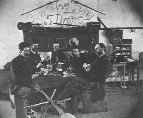 Union Soldiers playing cards and partaking in drink.