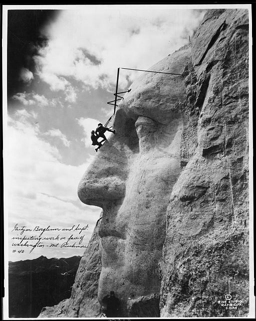 Borglum and one of his crew inspect the face of Washington (Library of Congress)
